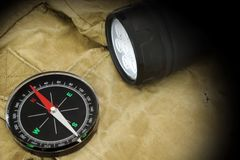 Searchlight and Compass on Backpack Stock Image