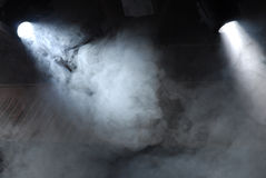 Searchlight in theatre. Light oftheatre searchlight in the fog Stock Photos