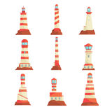 Searchlight towers for maritime navigational guidance set. Collection of lighthouses vector Illustrations. Isolated on a white background Royalty Free Stock Images