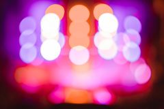 Searchlights at a concert. Stage lights on concert. Lighting equipment with multicolored beams Stock Image