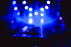 Searchlights at a concert. Stage lights on concert. Lighting equipment with multicolored beams Stock Images