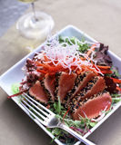 Seared Ahi Tuna. Seared Aui Tuna dish dish with white wine royalty free stock images