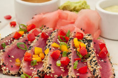 Seared Ahi Tuna with Sauces - horiz angle. Close-up shot of sliced Tuna appetizer Royalty Free Stock Image