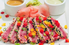 Seared Ahi Tuna with Sauces - horizontal. Seared Ahi Tuna with cream wasabi and peanut sauce Royalty Free Stock Images