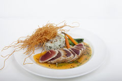 Seared ahi tuna with sushi roll Stock Photos