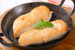 Seared chicken breast fillets Stock Photography