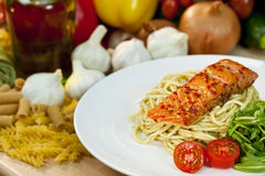 Seared Chili Salmon With Spaghetti & Rocket Stock Photography