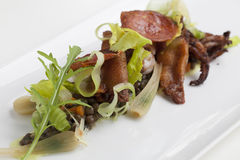 Seared Octopus with lentils Stock Images