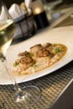 Seared scallops on a bed of risotto Stock Images
