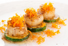 Seared scallops with citrus zest and sweet-sour sauce Stock Photography