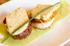 Seared Scallops with compound butter stock photos