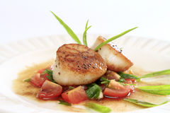 Seared scallops salsa. Seared scallops with tomato salsa and brown butter sauce stock photos