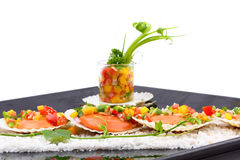 Seared scallops with tropical salsa Royalty Free Stock Images