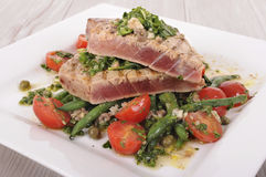 Seared tuna steak with bean and tomato salad Stock Image