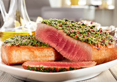 Seared Tuna Steaks Topped with Fresh Pesto Royalty Free Stock Images