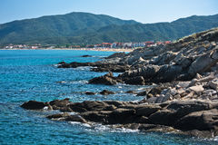 Searocks and big sandy beach of Sarti in background Stock Photos