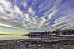 Searsport Maine Coastline Clouds. An early morning view of the Searsport coastline with windswept billowy clouds Royalty Free Stock Images