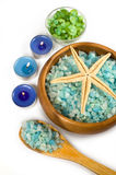 Seasalt and aromatic candles for spa. On a white background Stock Photo