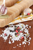 Seasalt and colorful pepper. On a wooden table. Seasoning for a dinner Stock Photos