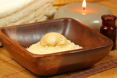 Seasalt and shell in spa. Spa and beauty treatment. Soothing therapy with seasalt in wooden bowl Royalty Free Stock Image