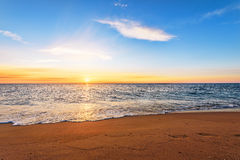Seascape во время захода солнца Стоковые Изображения