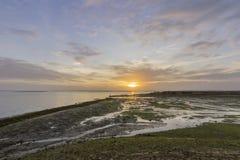 Seascape захода солнца портового района входа соленого болота Olhao Стоковые Фотографии RF