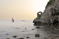 "Seascape. Scenic coastline tract, called ""Natural arch"", at the sunset, Palinuro, Italy Royalty Free Stock Photo"