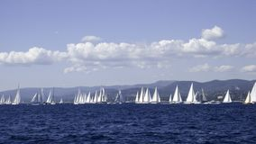 Seascape. Classic sailing yacht coastal regatta on a blue cloudy day Royalty Free Stock Photo