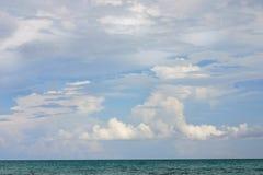 Seascape. Calm ocean water contrast a cloudy sky Royalty Free Stock Photos