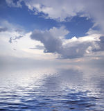 Seascape. The dark blue sea with clouds stock photography