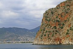 Seascape with Alanya`s castle rock peninsula and mountains. Turkey royalty free stock photos