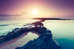 Seascape. Amazing morning sun over the sea. Volcanic island of Malta. Qawra, Europe. Beauty world. Retro toning effect Stock Images