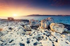 Seascape. Amazing morning sun over the sea. Volcanic island of Malta. Qawra, Europe. Beauty world. Retro toning effect Royalty Free Stock Photos