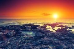 Seascape. Amazing red sun over the sea. Volcanic island of Malta. Qawra, Europe. Beauty world. Retro toning effect Royalty Free Stock Photo