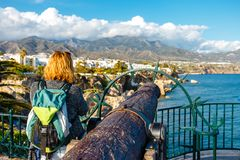 Ancient cannon on Playa Carabeillo beach in Nerja, Costa del Sol, Spain. Seascape with ancient cannon on Playa Carabeillo beach in Nerja, Costa del Sol, Spain royalty free stock images