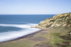 Seascape in Azkorri beach, Biscay, Spain. Long exposure shot, on a sunny day Stock Photo