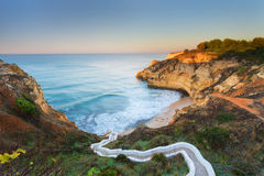 Seascape bay with serpentine steps. Portugal, Carvoeiro. Royalty Free Stock Photo