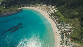Seascape with beach and sea. Philippines, Luzon. Aerial view of beautiful tropical beach with turquoise water in blue lagoon, Pagudpud, Philippines. Ocean stock photo