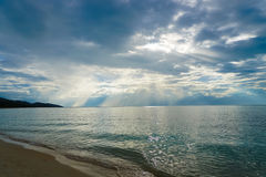 Seascape with Beams of light go through clouds. Beams of light go through clouds Stock Photos