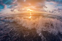 Seascape. Beautiful colorful sunset sky over the wavy sea. distortion perspective fisheye lens. View stock photos