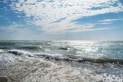 Seascape with beautiful white clouds, waves and horizon. Seascape with beautiful white clouds, waves and horizon Royalty Free Stock Photo