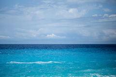 Seascape with blue color gradient. Sea with turquoise and deep blue color gradient blue sky and some clouds Stock Photos