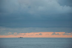 Seascape in blue with a ship on the horizon. In high quality Royalty Free Stock Photos