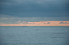 Seascape in blue with a ship on the horizon. In high quality Stock Photos