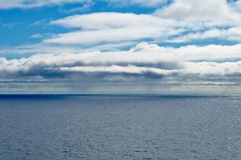 Seascape with blue sky and clouds stock image