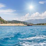 seascape, blue sky, sun, yacht Stock Photo