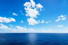 Seascape. Blue sky and white cloud. Royalty Free Stock Photos