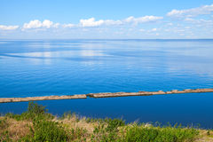 Seascape with blue water and blue cloudy sky Stock Photography