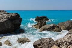 Seascape of blue waters and rocks of Megali Petra Beach, Lefkada, Ionian Islands, Greece stock photography