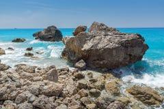 Seascape of blue waters and rocks of Megali Petra Beach, Lefkada, Ionian Islands, Greece stock photo